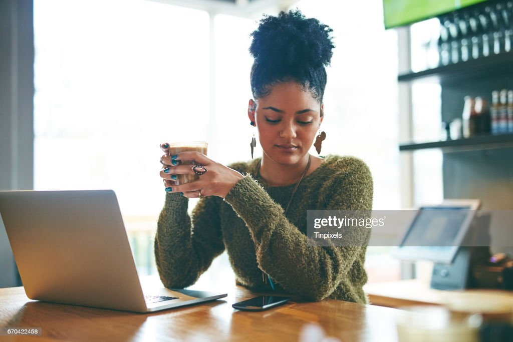 Connected at her favourite cafe : Stock Photo
