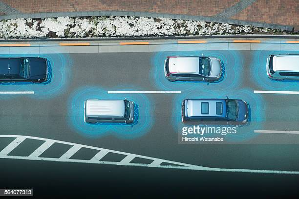 Connected cars running on the road elevated view