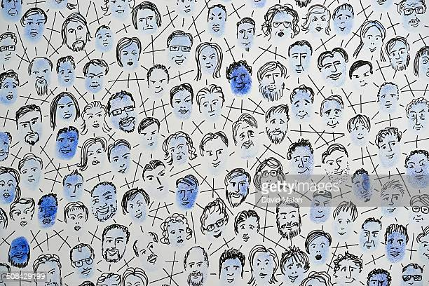 Connected fingerprints with faces drawn on them