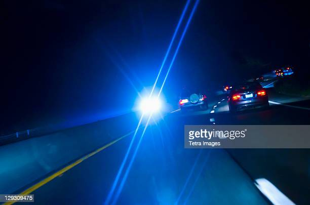 USA, Connecticut, Car headlights on road at night