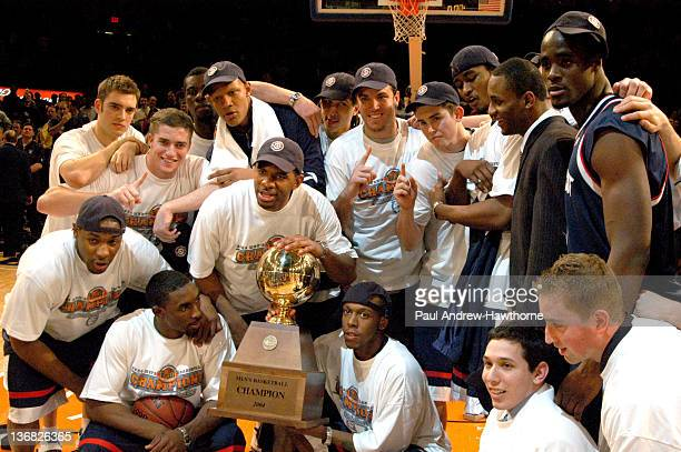 Connecticut celebrates after their win over Pittsburgh at Madison Square Garden in New York City March 13 during the 2004 Big East Men's Basketball...