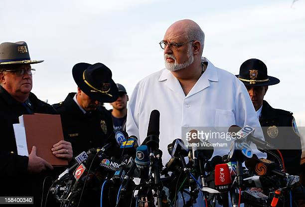 Connecticut Chief Medical Examiner H Wayne Carver II talks to the media and answers questions the media about the elementary school shooting during a...
