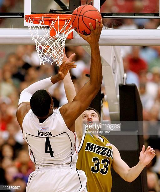 Connecticut forward Jeff Adrien shoots over Missouri guard Matt Lawrence during the men's NCAA college basketball regional tournament on Saturday...