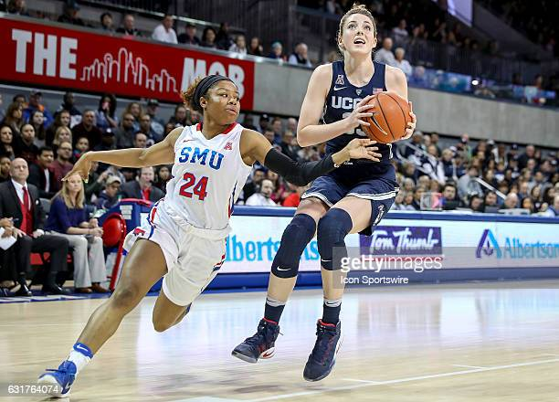 Connecticut forward Katie Lou Samuelson goes to the basket against SMU guard Kamray Mickens during the NCAA women's basketball game between the...