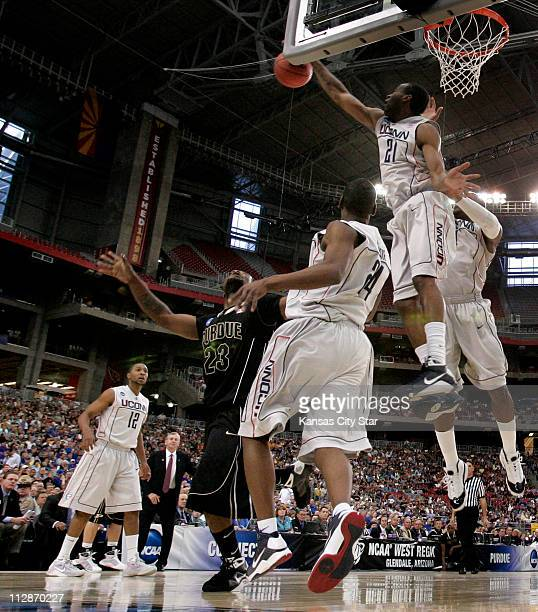 Connecticut forward Stanley Robinson denied a shot byPurdue guard Lewis Jackson in a NCAA men's college basketball tournament game on Thursday March...