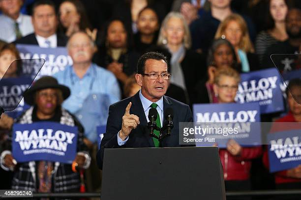 Connecticut Governor Dan Malloy speaks moments before US President Barack Obama comes out to speak in support of him on November 2 2014 in Bridgeport...