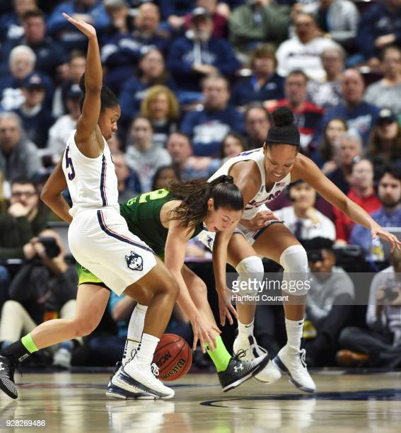 Connecticut guard Crystal Dangerfield and Connecticut forward Azura Stevens force a turnover from South Florida guard Laia Flores during the first...