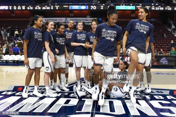 Connecticut guard Crystal Dangerfield and Connecticut forward Gabby Williams do a jig after posing with their team for photos with the American...