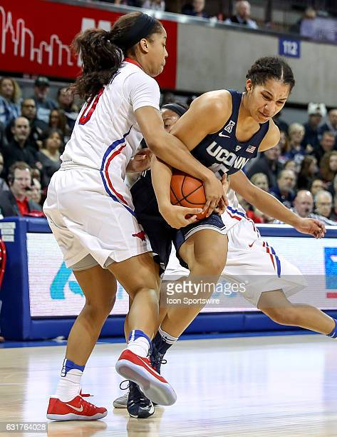 Connecticut guard Gabby Williams is tighted up with SMU guard Kiara Perry during the NCAA women's basketball game between the Connecticut Huskies and...