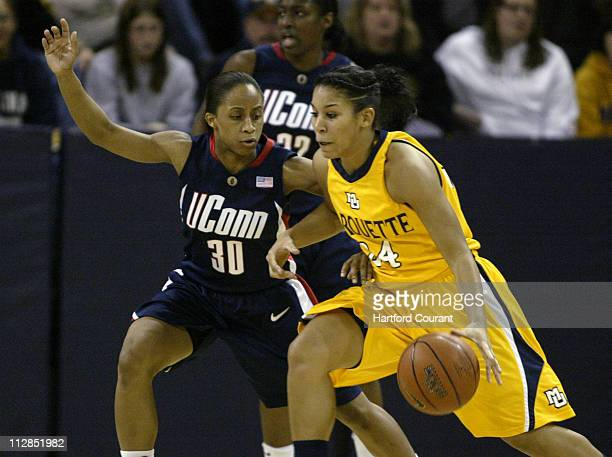 Connecticut guard Lorin Dixon defends against Lauren Thomas-Johnson of Marquette in second-half action of their NCAA women's basketball game on...