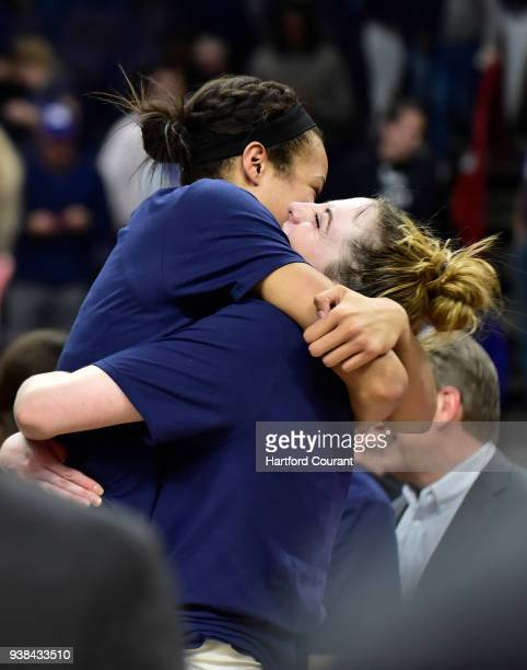 Connecticut guard/forward Katie Lou Samuelson picks up Connecticut forward Napheesa Collier in jubilation after the Huskeis defeated South Carolina...