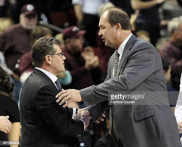 Connecticut head coach Geno Auriemma left is congratulated by Brigham Young head coach Jeff Judkins after UConn defeated BYU 7051 in the Lincoln...