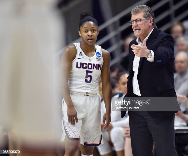 Connecticut head coach Geno Auriemma right speaks with Huskies guard Crystal Dangerfield in the first round of the NCAA Tournament against St Francis...