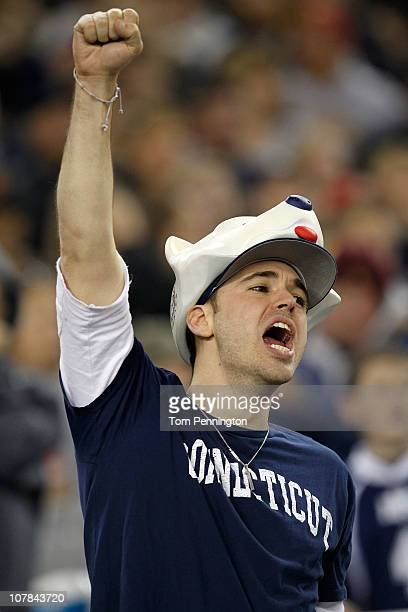 Connecticut Huskies fans cheer in the first half while taking on the Oklahoma Sooners during the Tostitos Fiesta Bowl at the Universtity of Phoenix...