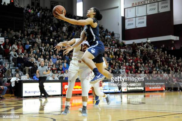 Connecticut Huskies forward Gabby Williams drives around Temple Owls guard Emani Mayo but misses the bucket during the first half on Sunday Jan 21...