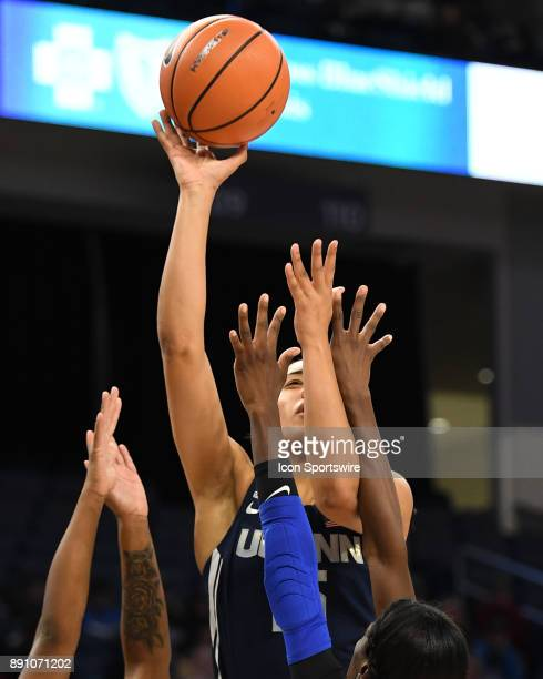 Connecticut Huskies forward Gabby Williams goes up for a shot against DePaul Blue Demons guard Tanita Allen and DePaul Blue Demons forward Chante...