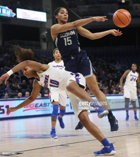 Connecticut Huskies forward Gabby Williams passes the ball as she runs into DePaul Blue Demons guard Amarah Coleman in the first half at Wintrust...