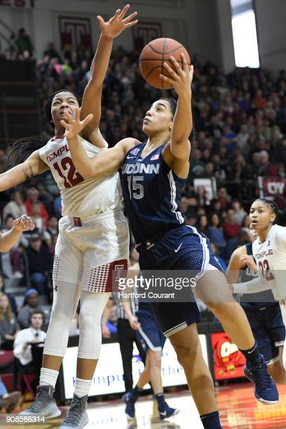 Connecticut Huskies forward Gabby Williams shoots as Temple Owls guard Emani Mayo defends during the first half on Sunday Jan 21 2018 at McGonicle...