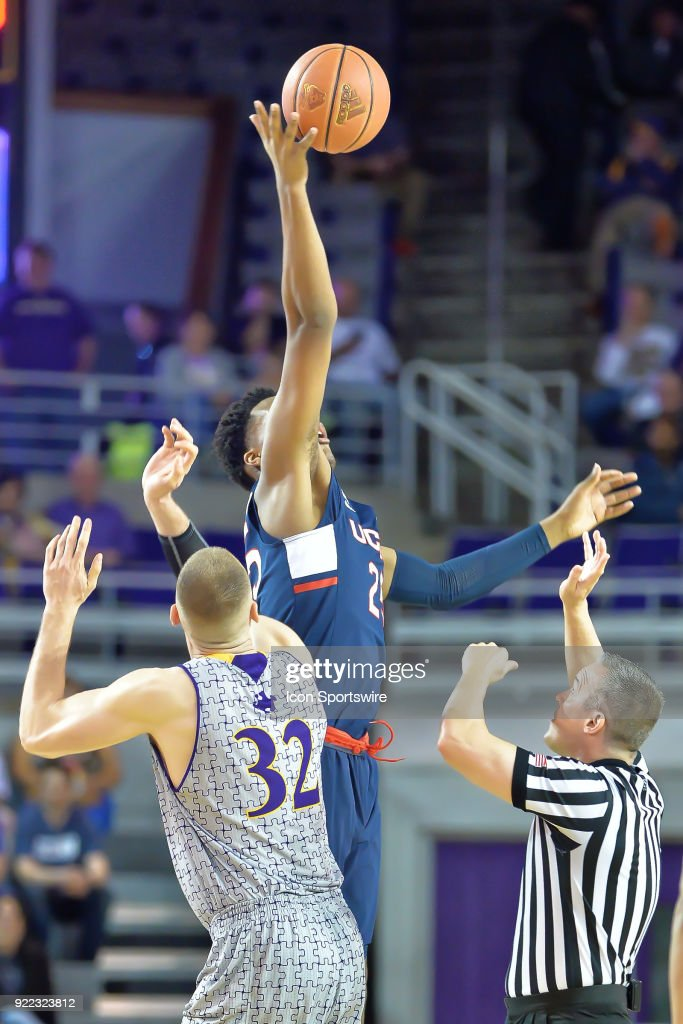 Connecticut Huskies forward Josh Carlton (25) and East Carolina Pirates forward Dimitri Spasojevic (32) jump at the opening tip during a game between the ECU Pirates and the UConn Huskies at Williams Arena - Minges Coliseum in Greenville, NC on February 18, 2018.