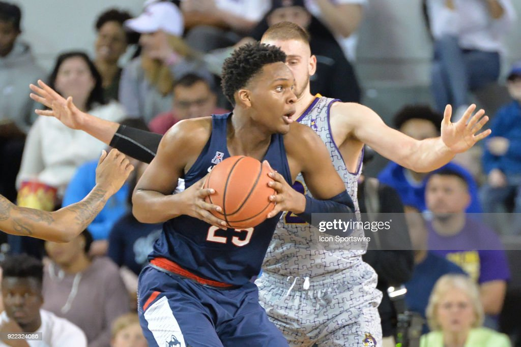 Connecticut Huskies forward Josh Carlton (25) is guarded by East Carolina Pirates forward Dimitri Spasojevic (32) during a game between the ECU Pirates and the UConn Huskies at Williams Arena - Minges Coliseum in Greenville, NC on February 18, 2018.