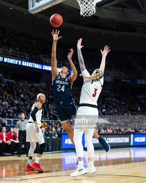 Connecticut Huskies Forward Napheesa Collier shoots a layup with Louisville Cardinals Forward Sam Fuehring defending during the first half of the...