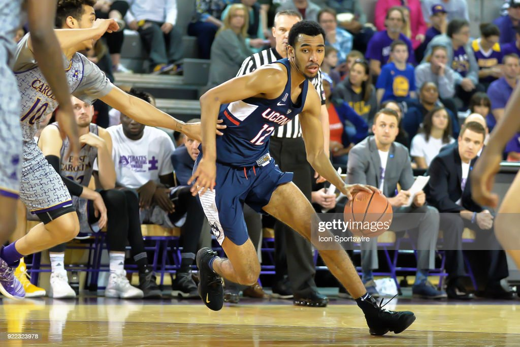 Connecticut Huskies forward Tyler Polley (12) dribbles the ball in the back court during a game between the ECU Pirates and the UConn Huskies at Williams Arena - Minges Coliseum in Greenville, NC on February 18, 2018.