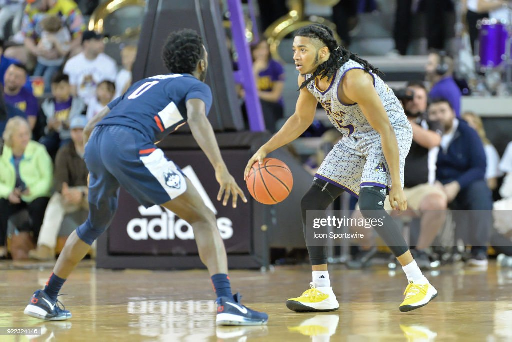 Connecticut Huskies guard Antwoine Anderson (0) guards East Carolina Pirates guard Shawn Williams (55) during a game between the ECU Pirates and the UConn Huskies at Williams Arena - Minges Coliseum in Greenville, NC on February 18, 2018.