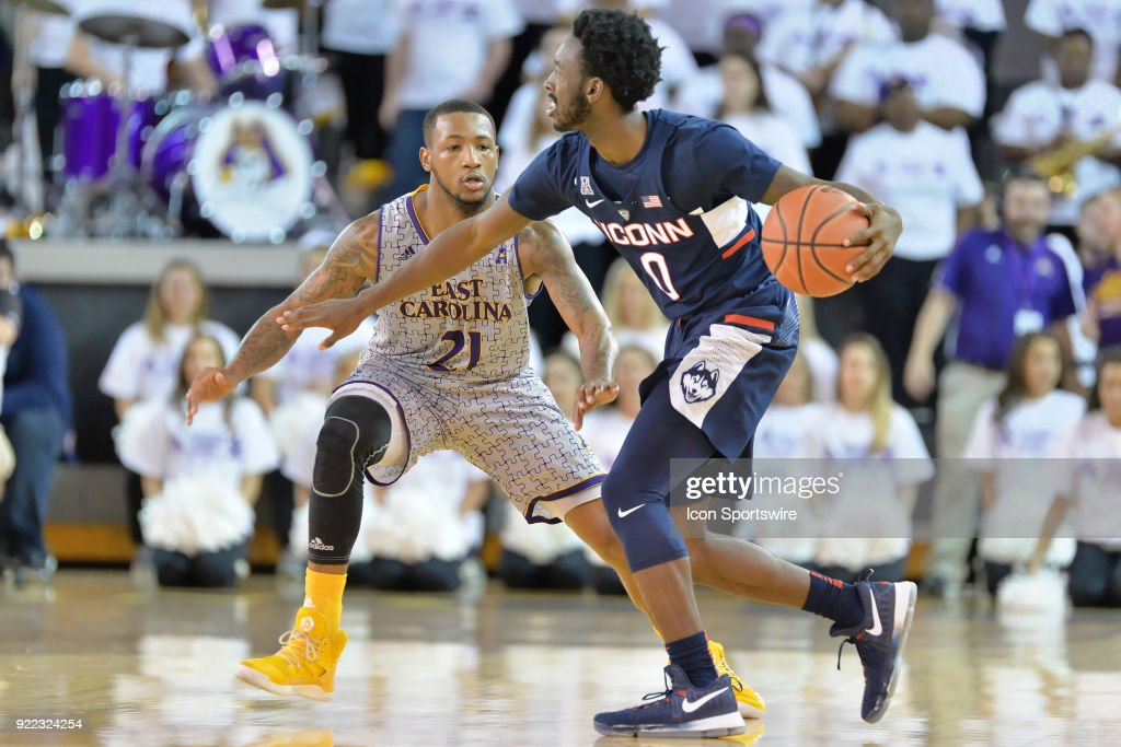 Connecticut Huskies guard Antwoine Anderson (0) is guarded by East Carolina Pirates guard B.J. Tyson (21) during a game between the ECU Pirates and the UConn Huskies at Williams Arena - Minges Coliseum in Greenville, NC on February 18, 2018.