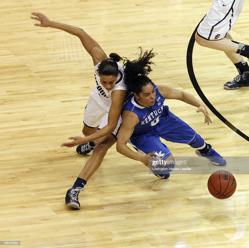 Connecticut Huskies guard Bria Hartley (14) and Kentucky Wildcats guard Jennifer O'Neill (0) chase a loose ball during first-half action in the NCAA women's regional finals at Webster Bank Arena in Bridgeport, Connecticut, Monday, April 01, 2013.