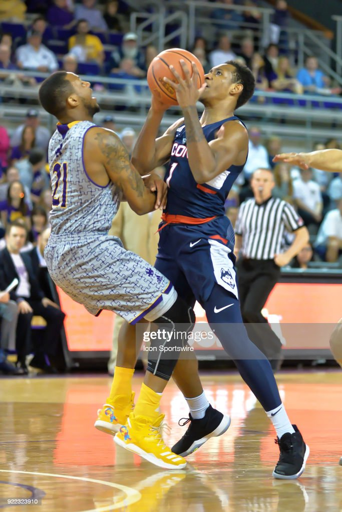 Connecticut Huskies guard Christian Vital (1) is called for a charging foul on East Carolina Pirates guard B.J. Tyson (21) during a game between the ECU Pirates and the UConn Huskies at Williams Arena - Minges Coliseum in Greenville, NC on February 18, 2018.