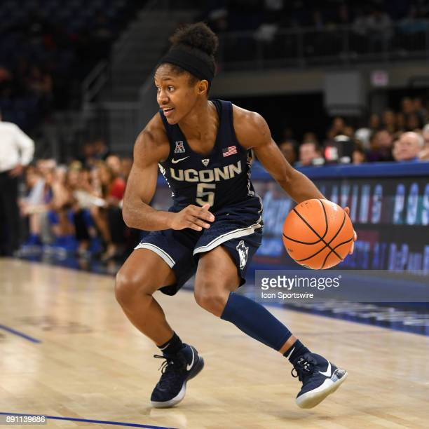 Connecticut Huskies guard Crystal Dangerfield controls the ball during a game between the Connecticut Huskies and the DePaul Blue Demons on December...