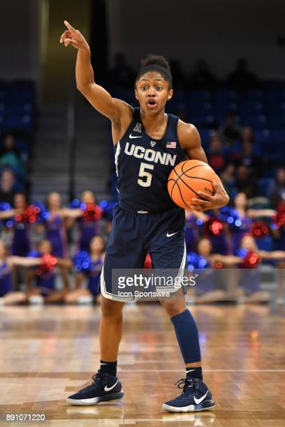 Connecticut Huskies guard Crystal Dangerfield controls the ball in the first half during a game between the Connecticut Huskies and the DePaul Blue...