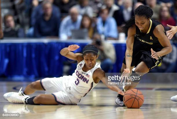 Connecticut Huskies guard Crystal Dangerfield dives on the floor for the steal from UCF Knights guard Zykira Lewis in a semifinal game of the AAC...