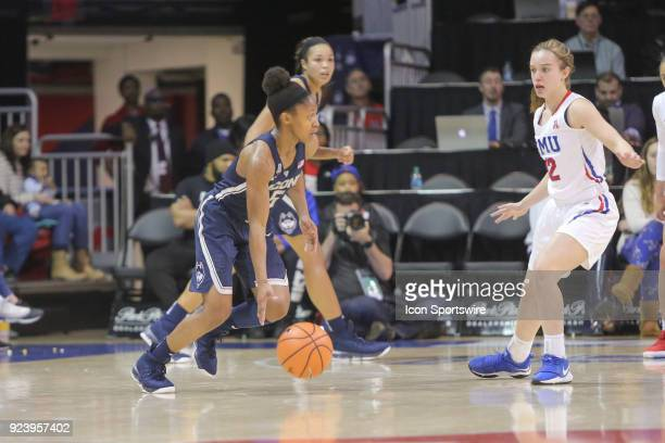 Connecticut Huskies guard Crystal Dangerfield dribbles during the game between SMU and UConn on February 24 at Moody Coliseum in Dallas TX