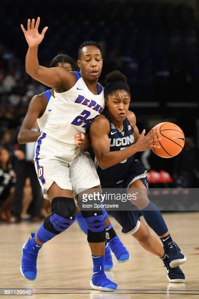 Connecticut Huskies guard Crystal Dangerfield drives against DePaul Blue Demons guard Tanita Allen during a game between the Connecticut Huskies and...