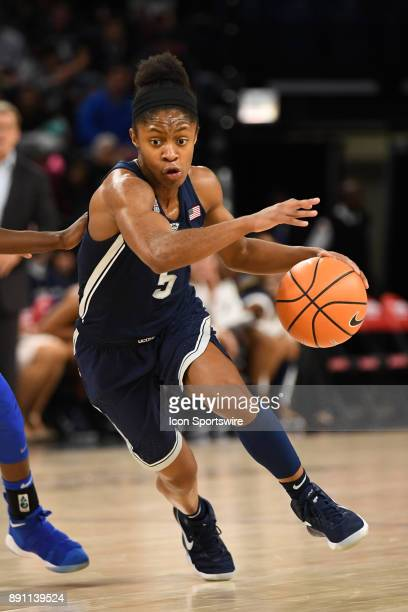 Connecticut Huskies guard Crystal Dangerfield drives towards the basket during a game between the Connecticut Huskies and the DePaul Blue Demons on...