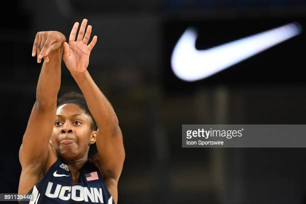 Connecticut Huskies guard Crystal Dangerfield goes up for a shot in the first half during a game between the Connecticut Huskies and the DePaul Blue...