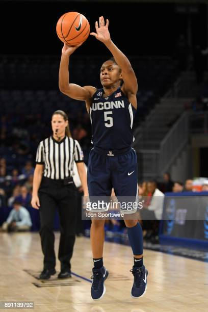 Connecticut Huskies guard Crystal Dangerfield goes up for a three point shot during a game between the Connecticut Huskies and the DePaul Blue Demons...