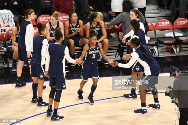 Connecticut Huskies guard Crystal Dangerfield is introduced prior to a game between the Connecticut Huskies and the DePaul Blue Demons on December 8...