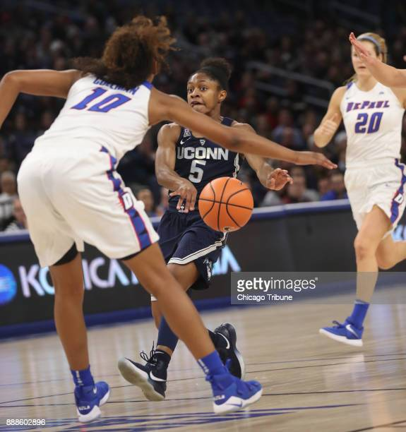 Connecticut Huskies guard Crystal Dangerfield passes the ball as DePaul Blue Demons guard Amarah Coleman defends in the first half at Wintrust Arena...