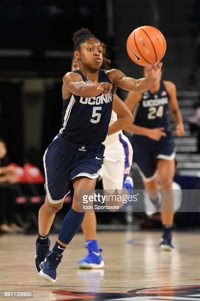 Connecticut Huskies guard Crystal Dangerfield passes the ball during a game between the Connecticut Huskies and the DePaul Blue Demons on December 8...
