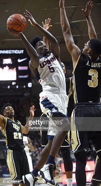 Connecticut Huskies guard Daniel Hamilton drives to the basket against UCF guard AJ Davis on Sunday March 6 at Gampel Pavilion in Storrs Conn...
