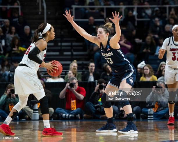 Connecticut Huskies Guard / Forward Katie Lou Samuelson defends against Louisville Cardinals Guard Asia Durr with the ball during the first half of...