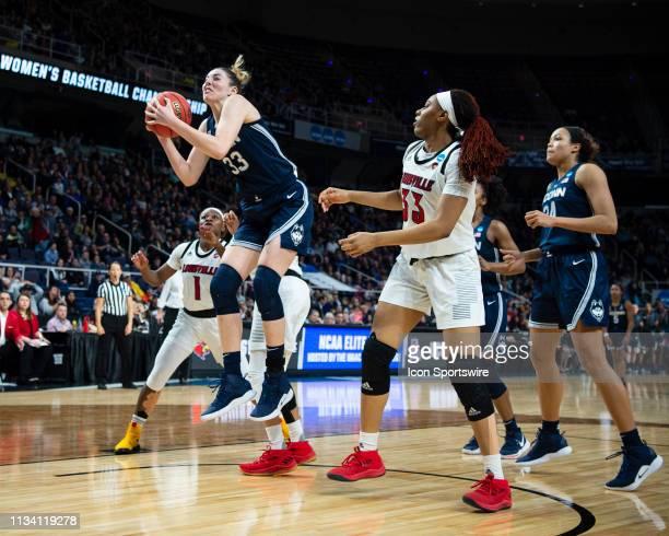 Connecticut Huskies Guard / Forward Katie Lou Samuelson grabs a rebound with Louisville Cardinals Guard Dana Evans and Louisville Cardinals Forward...