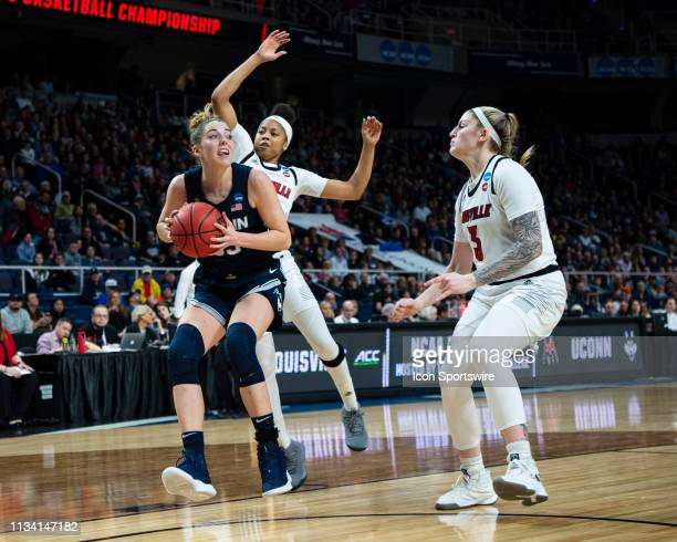 Connecticut Huskies Guard / Forward Katie Lou Samuelson looks to shoot the ball with Louisville Cardinals Guard Arica Carter and Louisville Cardinals...