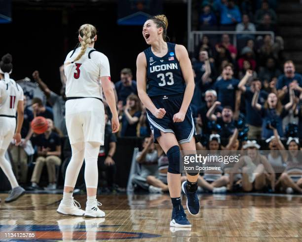 Connecticut Huskies Guard / Forward Katie Lou Samuelson reacts to hitting a three point shot during the second half of the game between the...