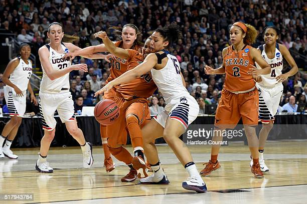 Connecticut Huskies guard Gabby Williams battles with Texas Longhorns guard Brianna Taylor for a rebound during the second half of their Elite Eight...