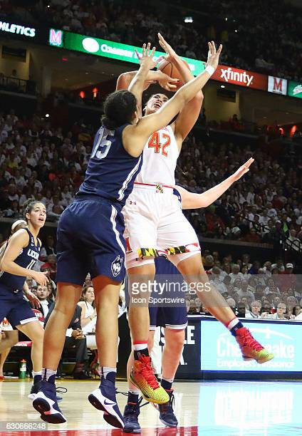 Connecticut Huskies guard Gabby Williams pushes into Maryland Terrapins center Brionna Jones during a NCAA women's basketball game on December 29 at...