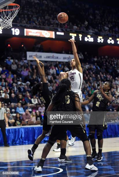 Connecticut Huskies guard Gabby Williams shoots over the UCF defense in a semifinal game of the AAC Women's Basketball Tournament on Sunday March 5...