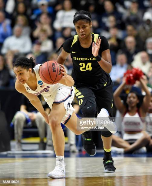 Connecticut Huskies guard Gabby Williams steals the ball from Oregon Ducks forward Ruthy Hebard during the first half in the East Regional Elite 8...